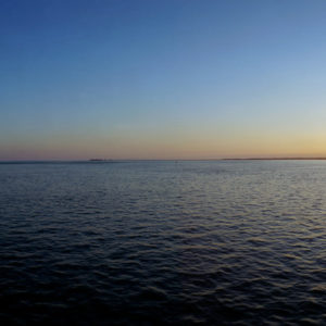 The Passage West to America, the Solent off the Isle of Wight, England. Sunset from the Iow ferry to Lymington.