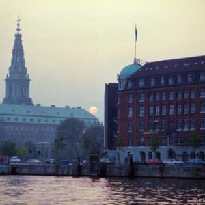 Inner Harbor, Copenhagen. The sun sets over the Hafnia and Parliament Buildings in August.