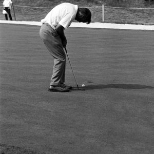 1965: Arnold Palmer putts. It was a very hot day with temps in the low 100's. Players and fans wilted in the heat. It was before TV and fans carried binoculars, not cameras.