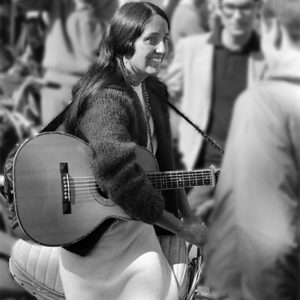 1966: Joan Baez, March on Washington. The weather was nice and so were the people. And there in the middle of the crowds was Bob Dylan's girl. Scorsese bought the shot for his movie on Dylan.