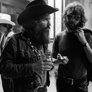 1971 : Dennis Hopper & Kris Kristofferson talking at  the Corcoran Gallery of Art while Hopper's show was being hung.